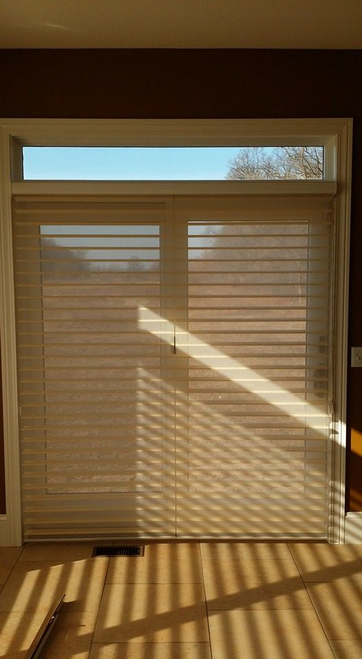 "Window treatment ideas for sliding glass doors - ""Window Shadings"" is an alternative to vertical blinds on a patio door or any large window. http://www.toledo-window-treatments-windows-blinds-coverings-drapery.com/"