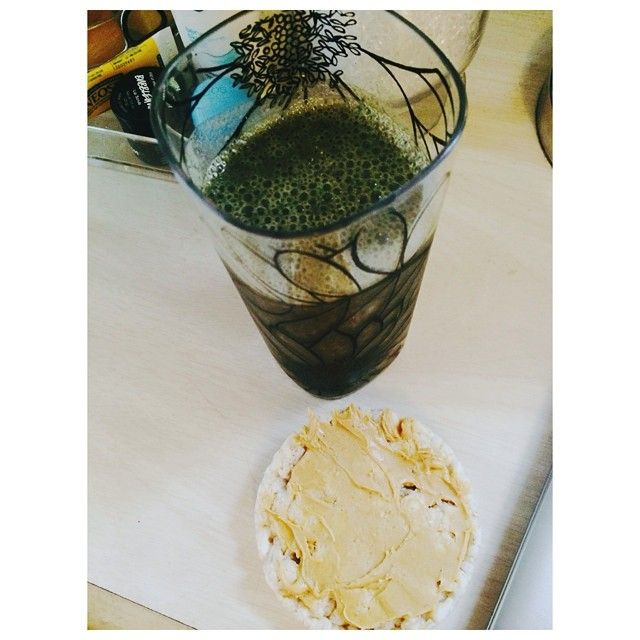 Here's my nasty looking snacks  delicious tho, I promise. A rice cake with @peanutbutterco white choc pb  & my smoothie: kale + blueberry + frozen pineapple + frozen banana + almond milk  Kale & blueberries always results in the sickest color lolz  #eatclean #fitfam #fitgirls #healthy #diet #kale #greensmoothie #drinkyourgreens #foodisfuel #strongnotskinny