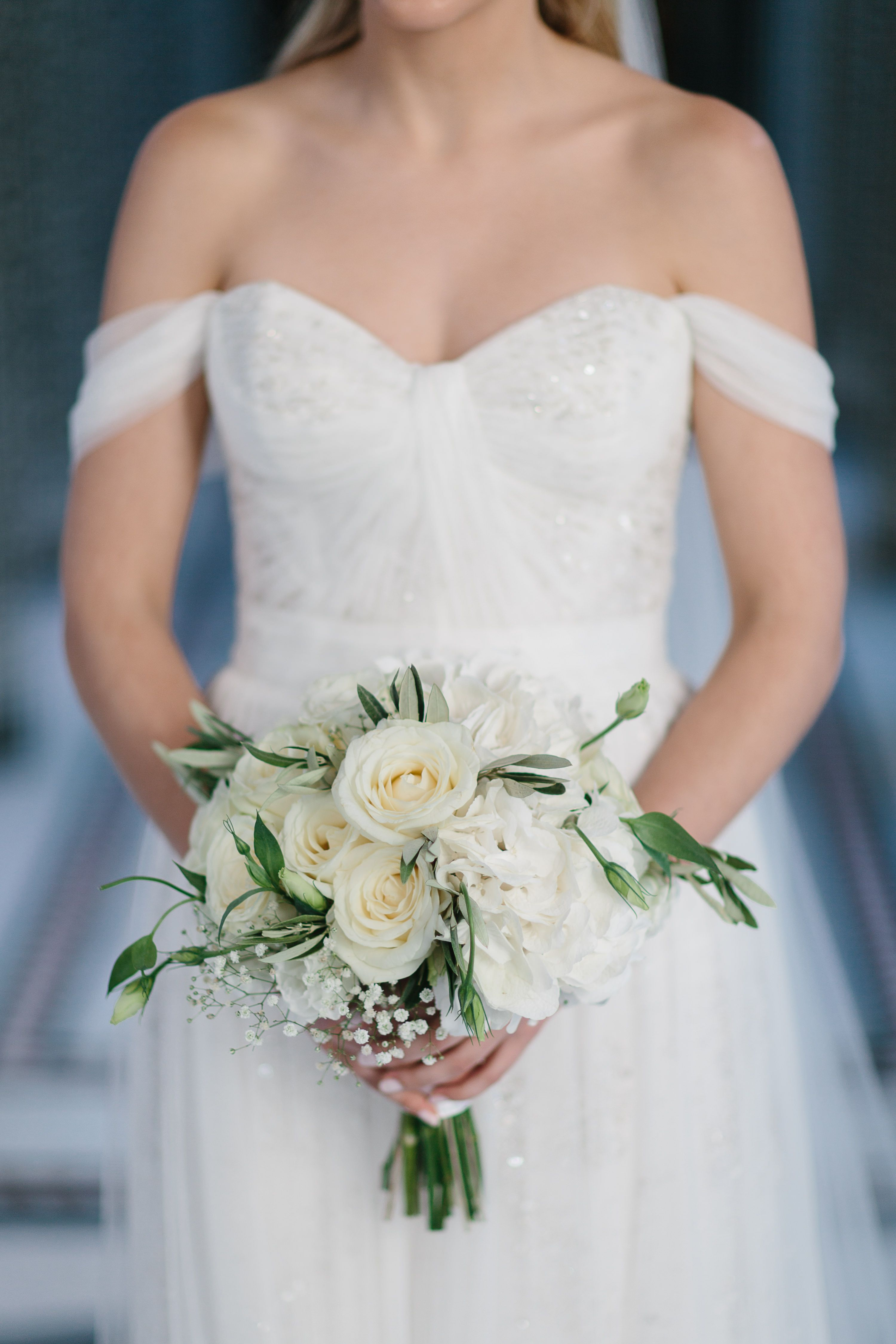 An Elegant But Simple Bridal Bouquet Of Ivory Roses Baby S Breath