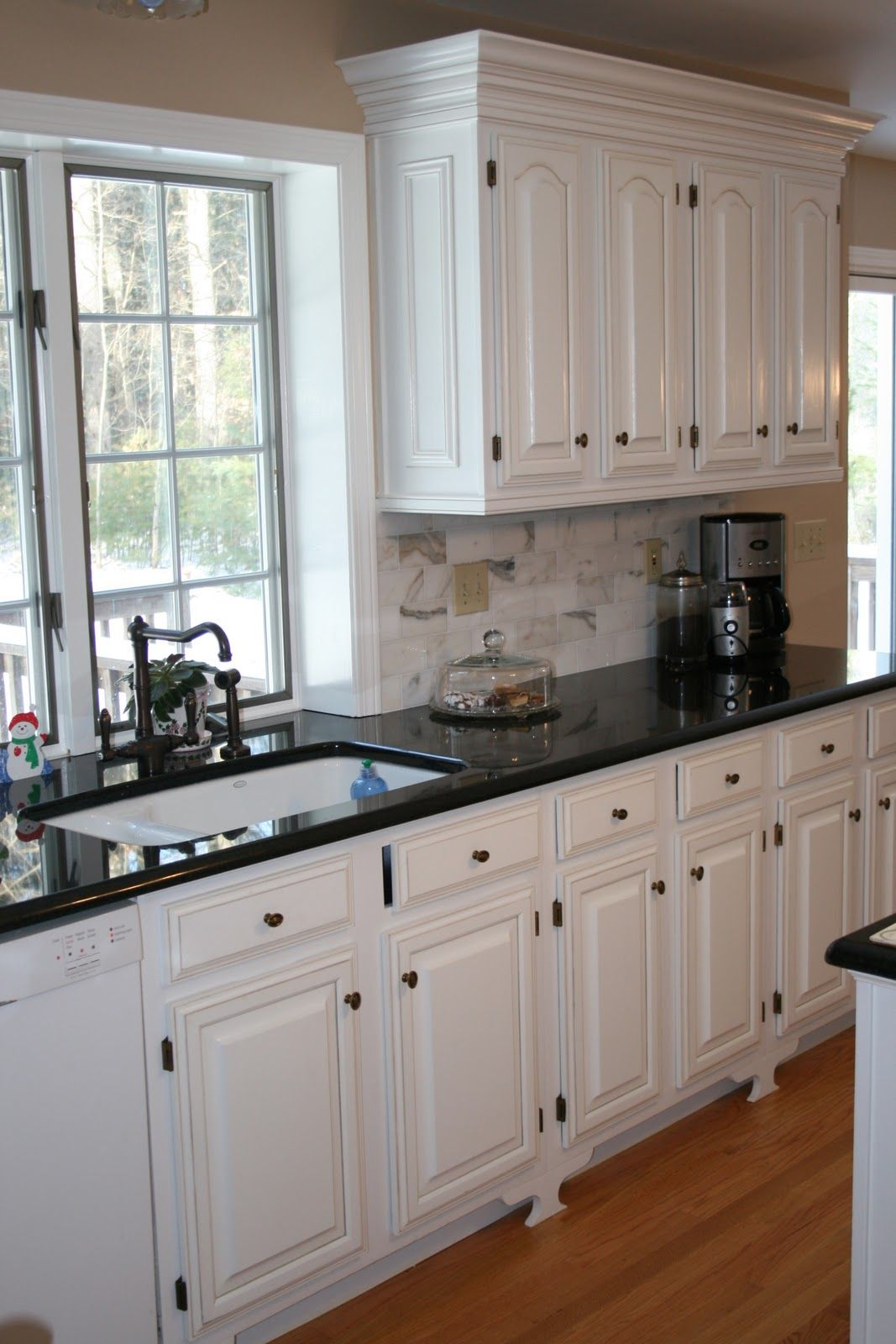 White cabinets black countertops and that faucet home for Black and white kitchens photos