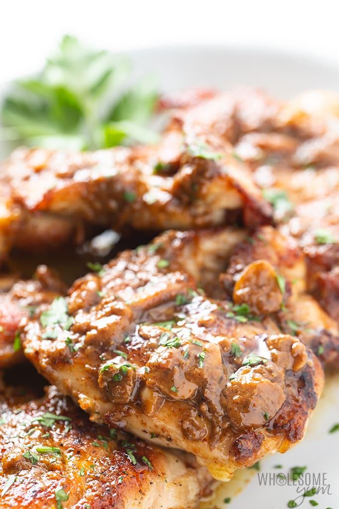 Creamy Garlic Chicken Thighs Recipe | Wholesome Yum #creamygarlicchicken