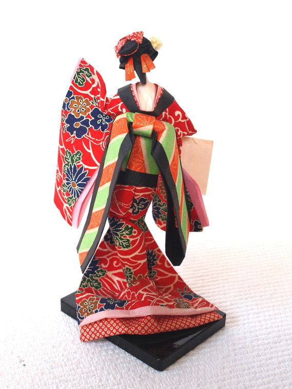Dancing Geisha doll made from washi traditional paper. Lacquered wood  platform. Such stunning and