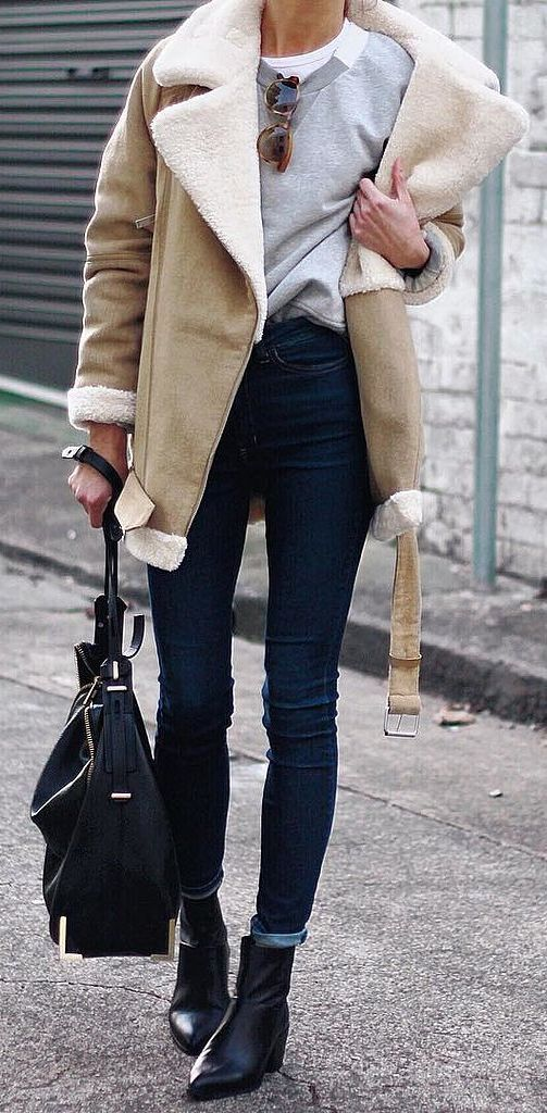 An aviator jacket layered over a basic sweatshirt.