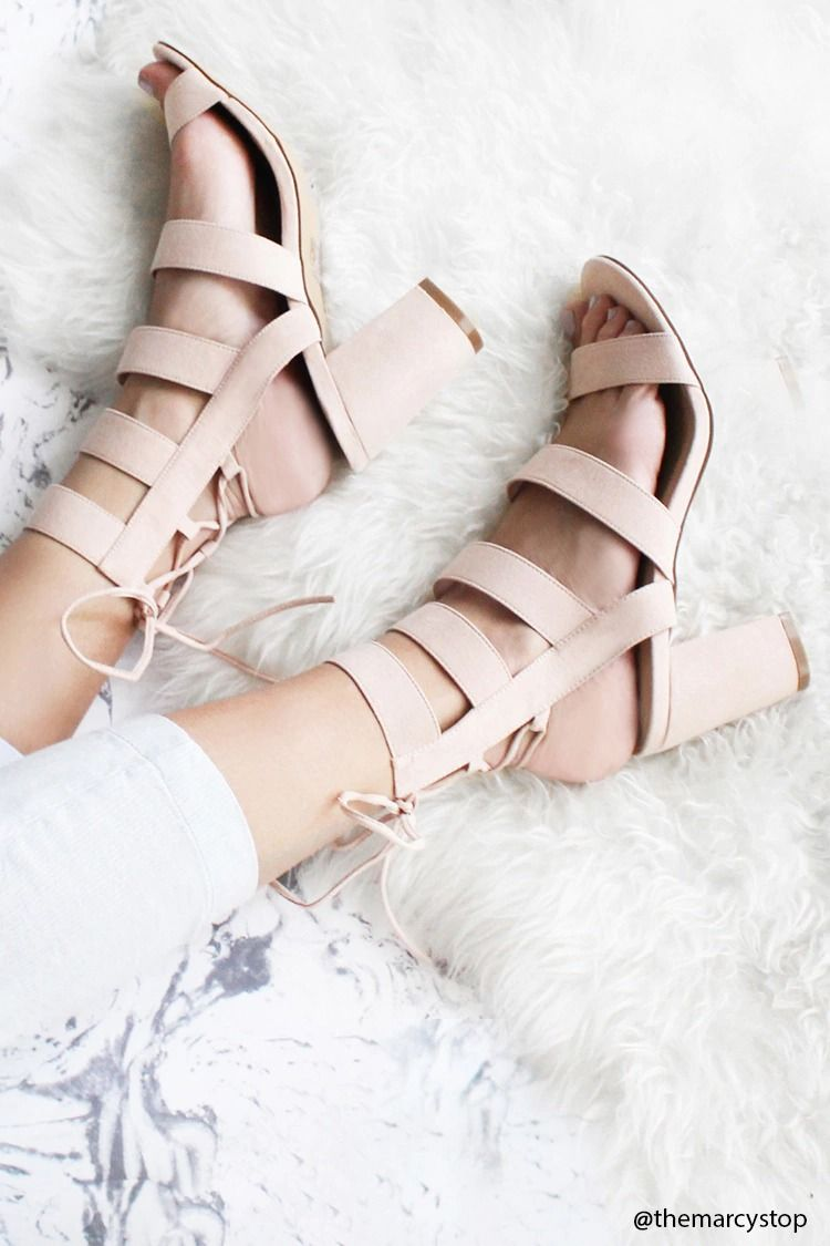 8cbf83a088a A pair of strappy faux suede heels with an open toe