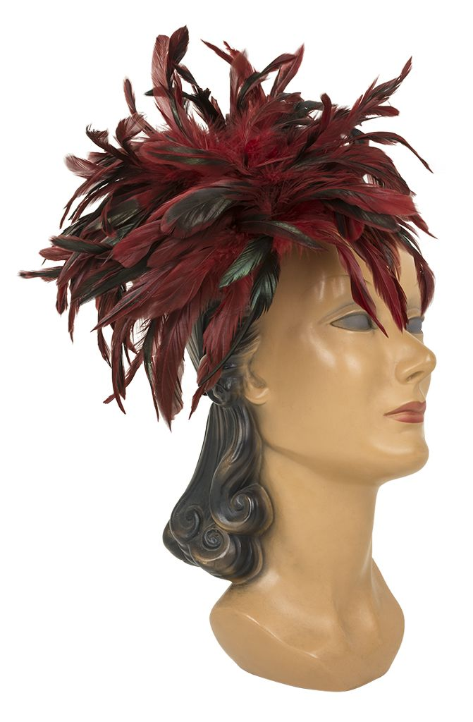This oversized Feather Headband in eye-catching red and black is sure to breathe new life into your retro-inspired ensemble!