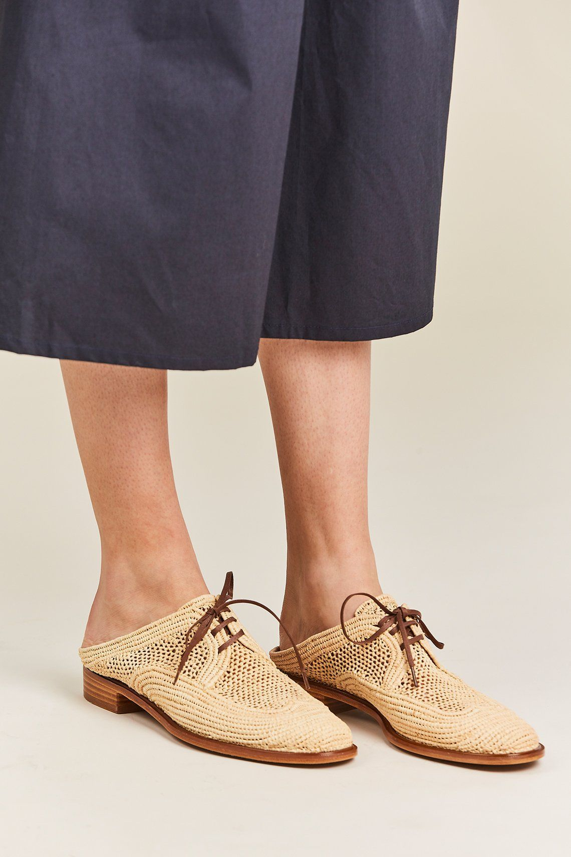 f20c52d091fde Hand-woven natural rafia mules with a oxford inspired silhouette. Round  toe
