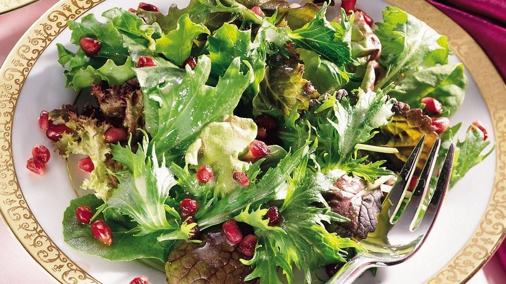 Winter sparkles with colorful pomegranate and a splash of champagne vinaigrette on fresh greens.