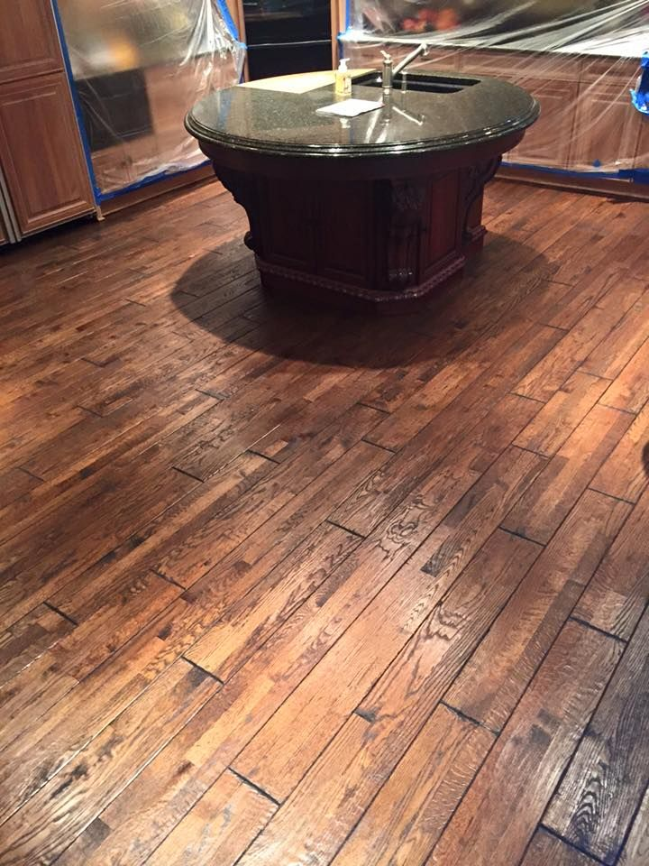 One of kind, hand-scraped floor by Walk on Wood out of McHenry, Illinois