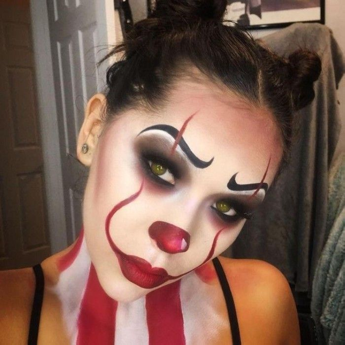 pennywise clown face paint, inspired by the film it, worn by a young woman with