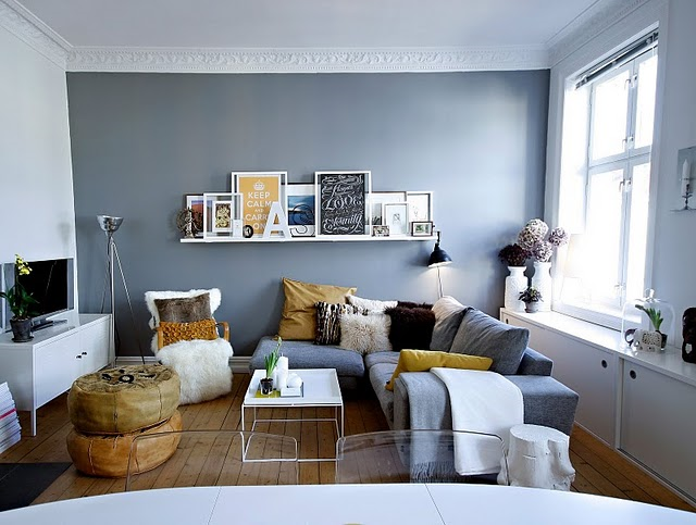 The Grey Blue Wall With Funky Pillows And Shelf For Living Room