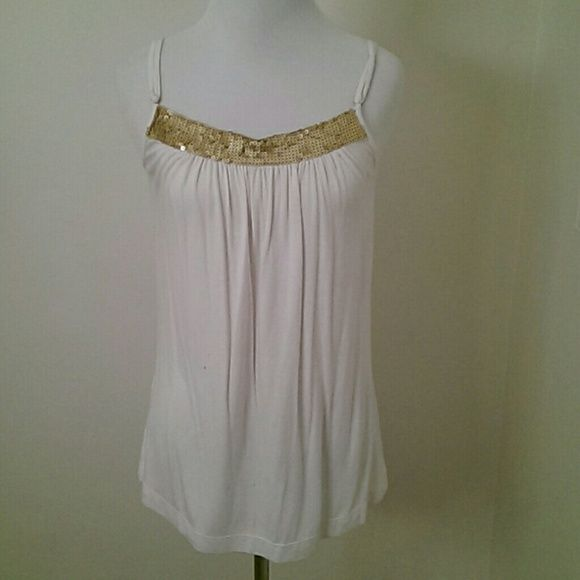 BCBG white jersey tank with gold sequins size S Pretty white jersey spaghetti strap tank from BCBG. Has band of matte gold sequins along neckline, sequins not glossy, so tank goes everywhere from casual to dressy. Adjustable straps. Fit is long, loose, and swingy. Great condition, worn only a few times. Size S. BCBGMaxAzria Tops Camisoles