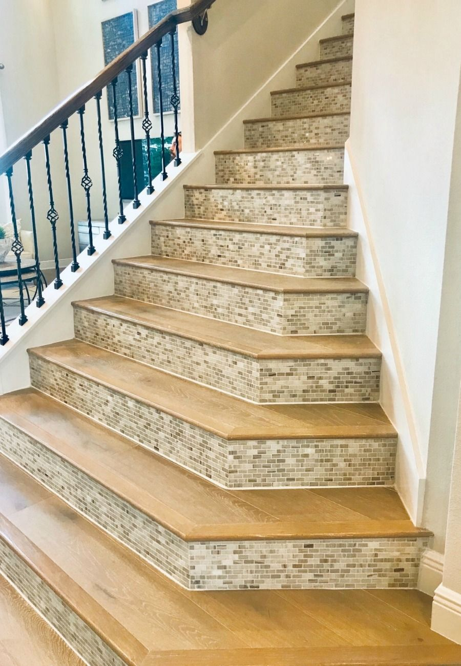 When selling your home it's important to stage each room as inspiration for your buyers to see themselves living in your home. Consider doing a staircase remodel with extra details to showcase the beauty of your open concept. #interiordesign #staging #realestate