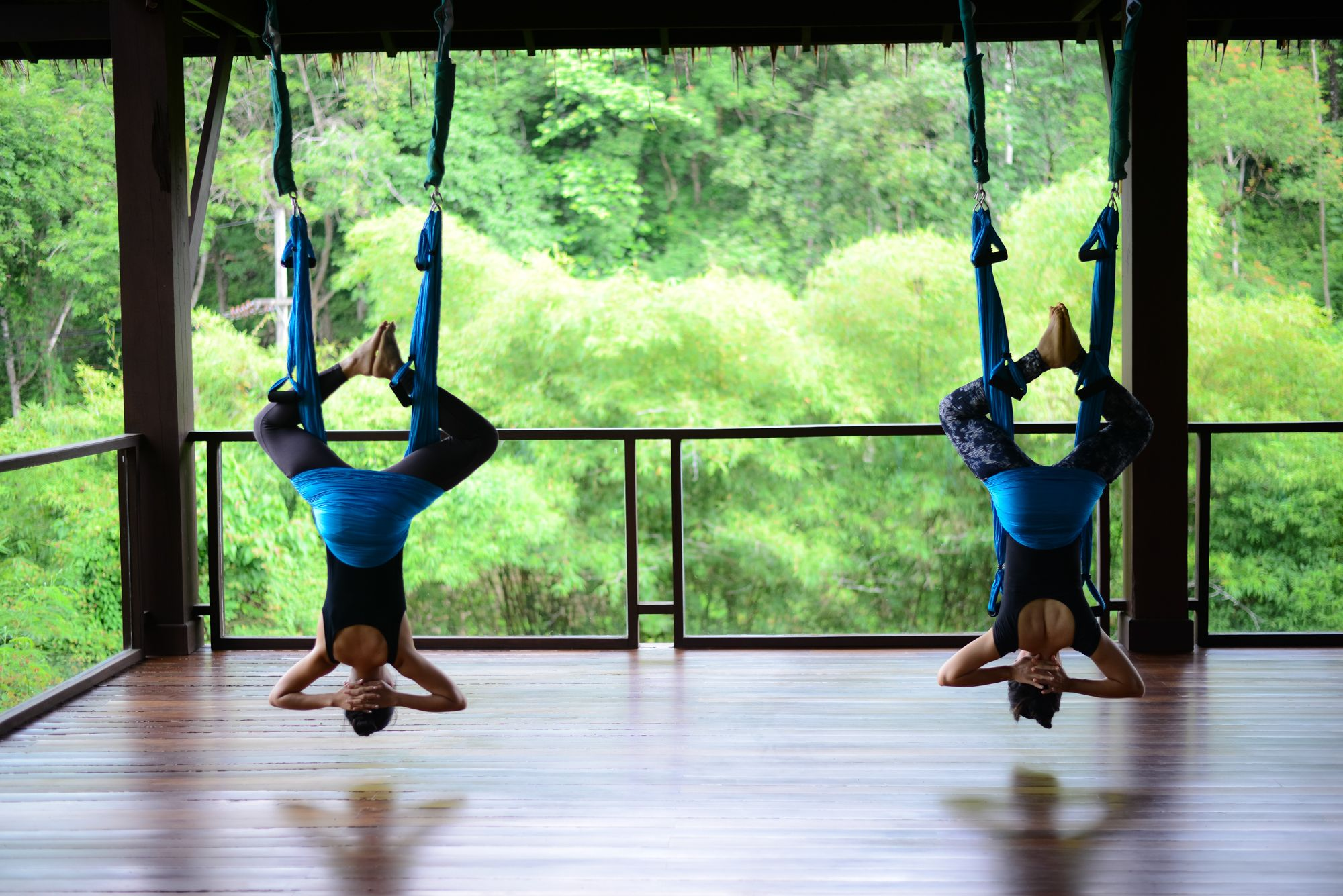Aerial yoga hatha yoga supported by a soft hammock to explore