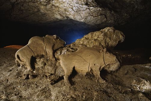 These clay bison figures date to 14,000 years ago. Tuc D'audoubert Cave, Pyrenees Mountains, France. Photographer: SISSE BRIMBERG/National Geographic Stock