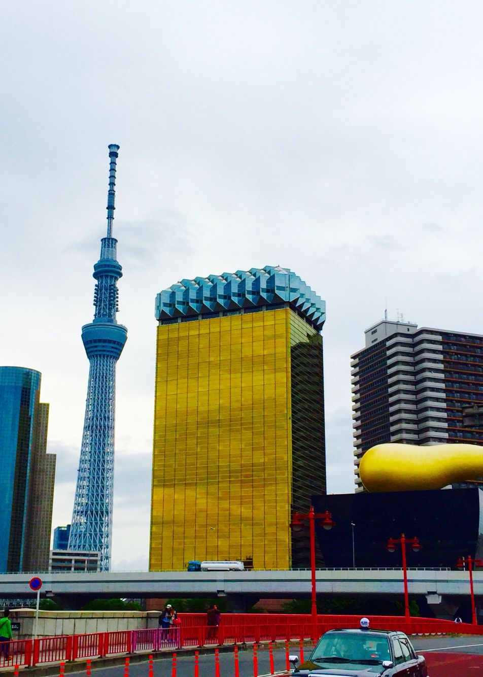 SkyTree. And the building that looks like beer is The headquarters of Asahi Beer.