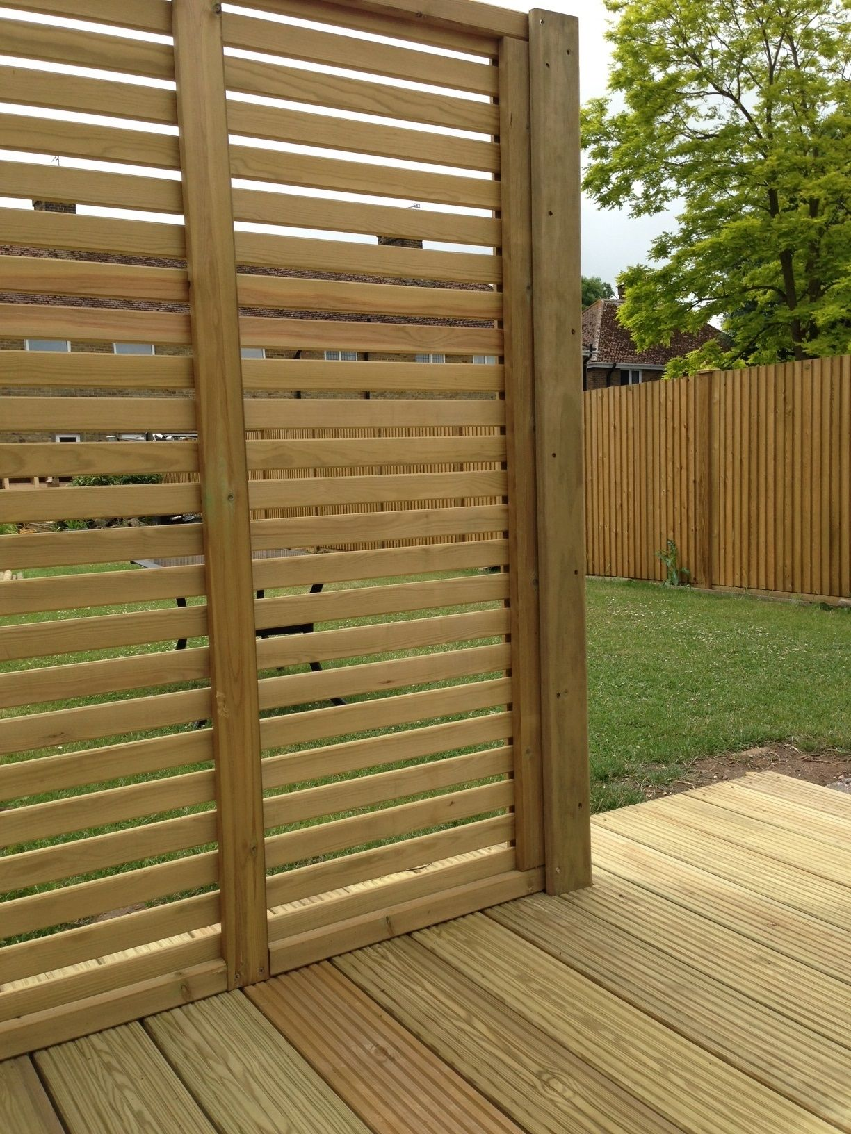 Jacksons timber decking and a venetian fence panel - used as a ...