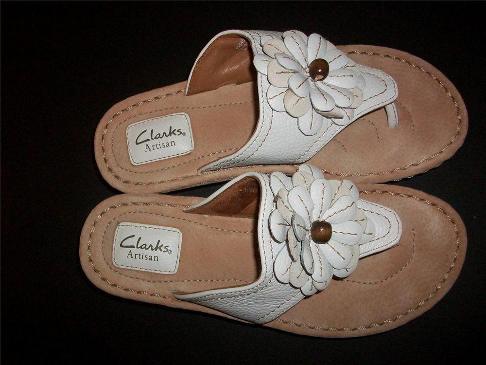 white clarks flip flops