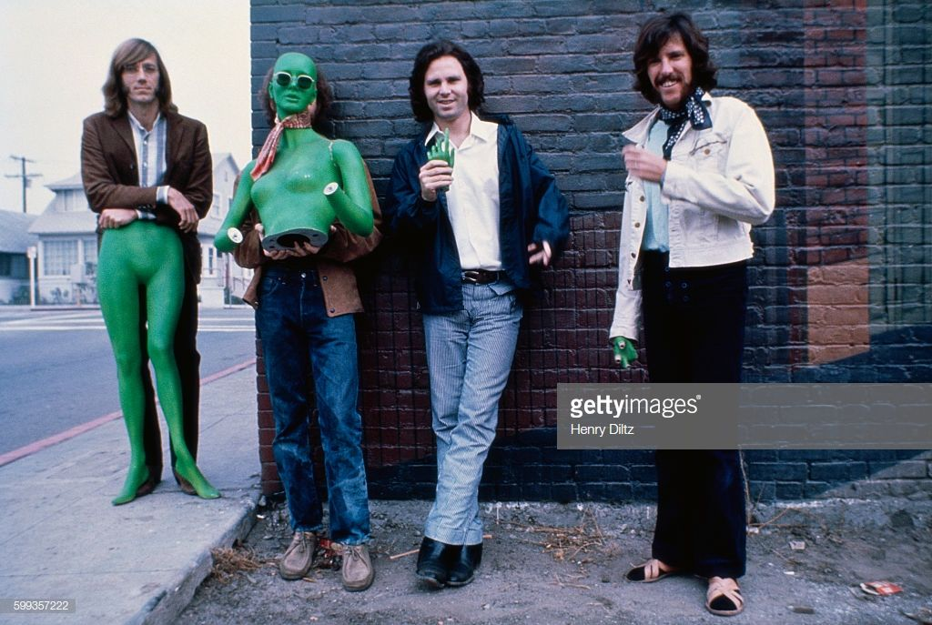 Los Angeles Rock Band The Doors Stand Alongside A Brick Building