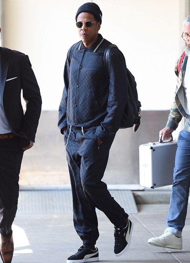 47c350a3b98 Jay-Z Lands at JFK Wearing Alexander Wang Beanie