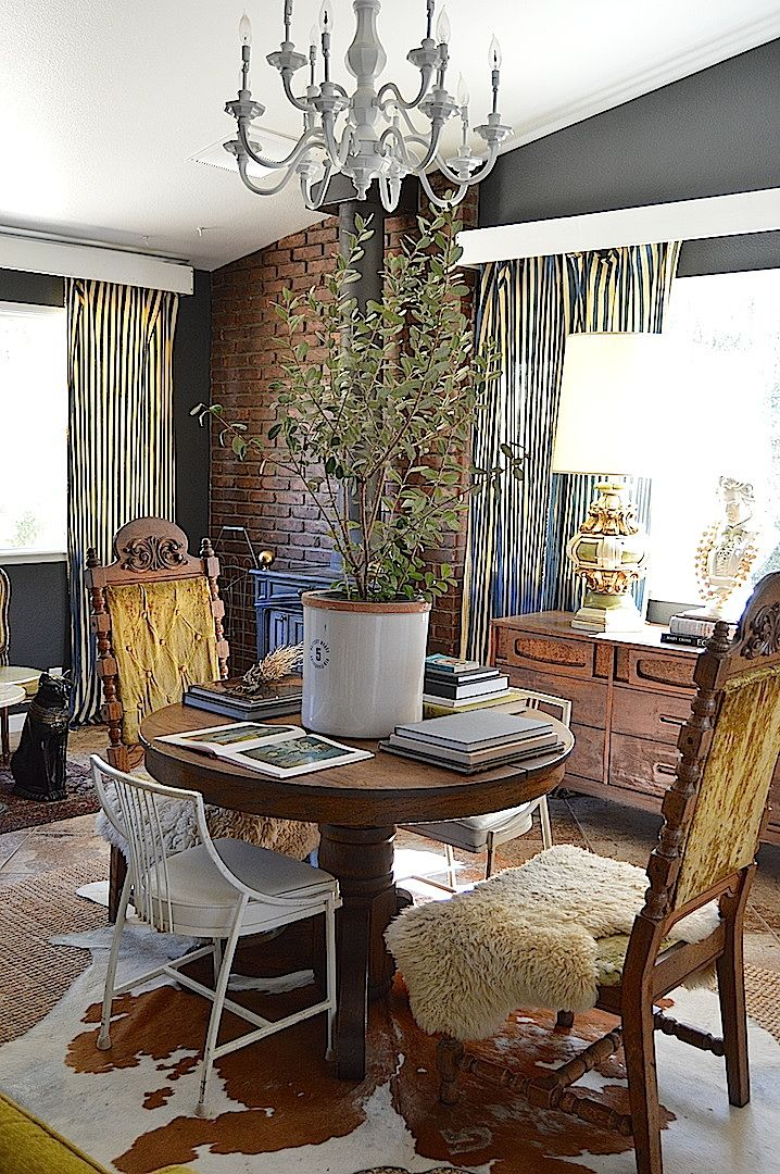 A mid century modern   eclectic country cottage living room with masculine  elements   combining cowhides. A mid century modern   eclectic country cottage living room with