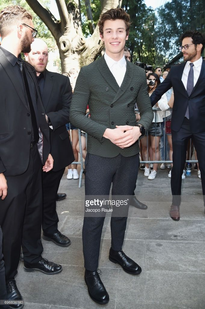 63f1b7a3a8ea6 Shawn Mendes arrives at the Emporio Armani show during Milan Men s Fashion  Week Spring Summer 2018 on June 17, 2017 in Milan, Italy.
