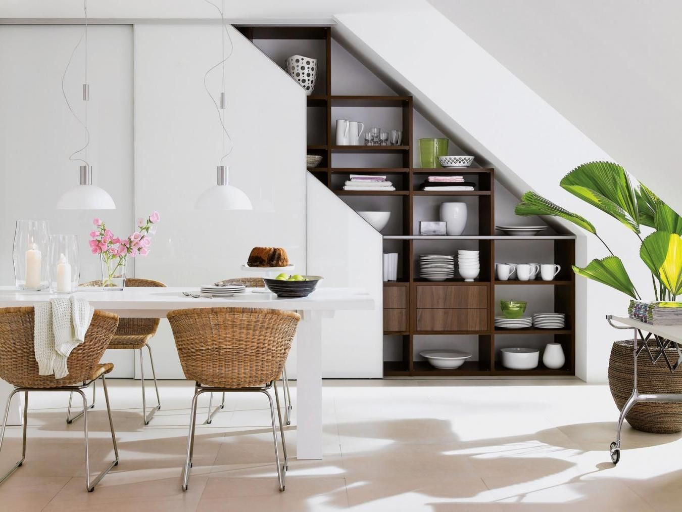 Nice wooden shelving for dining set under the staircase along with a