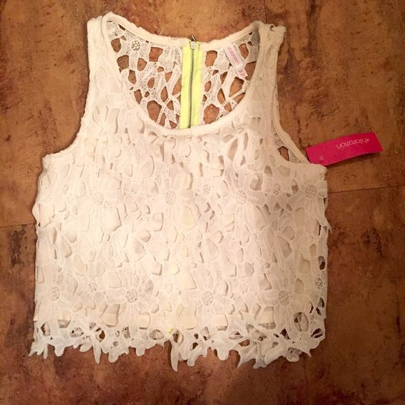 White crop top tank Never worn (still tags) white crop top tank! Has material in the front so it isn't see through, but completely sheer in the back  Tops Crop Tops
