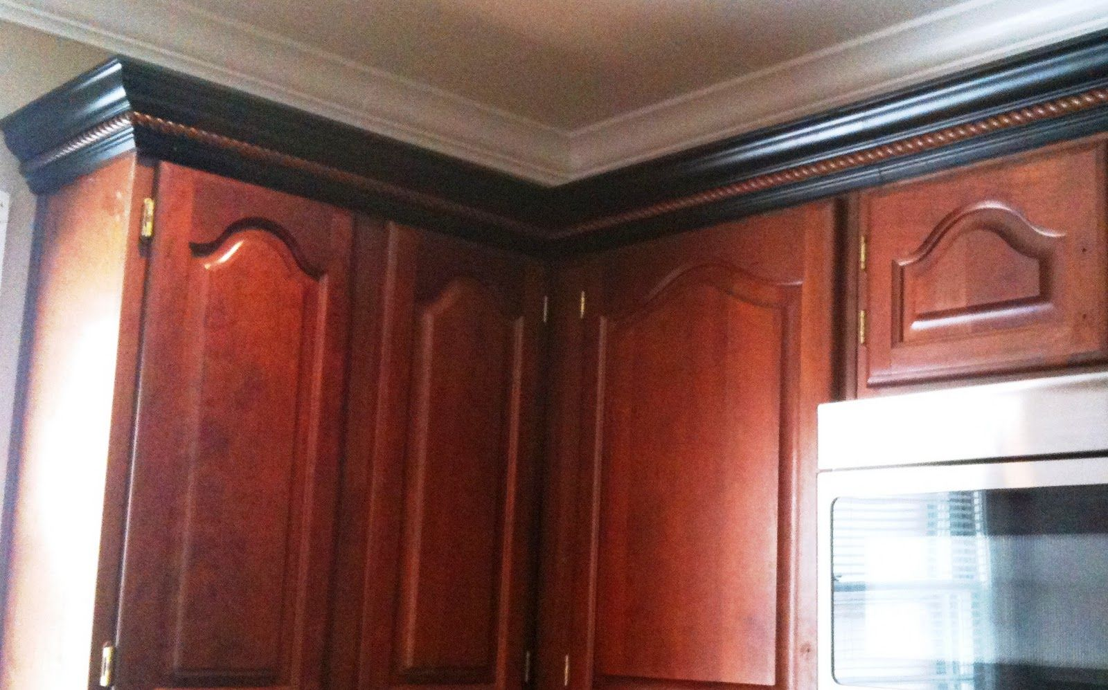 Cherry cabinets black molding black crown molding kitchen ideas
