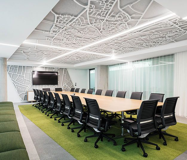 Laser cut ceiling with green flooring in boardroom for Office design video conferencing