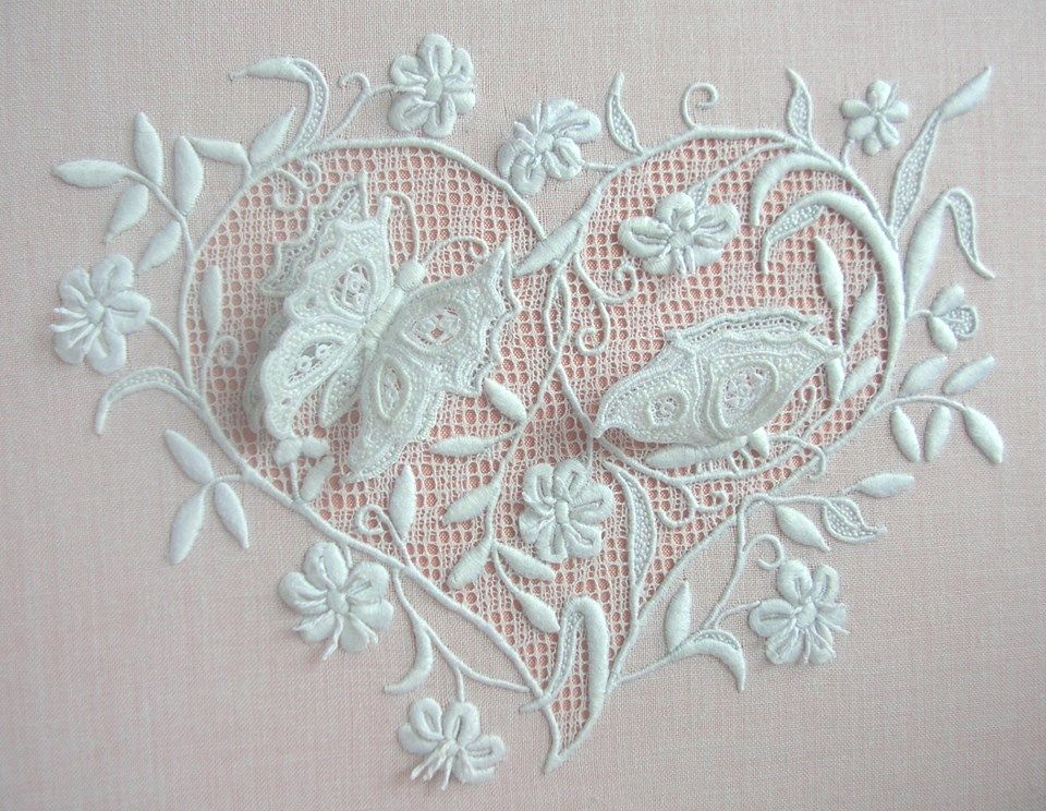 This piece of whitework features stumpwork butterflies set
