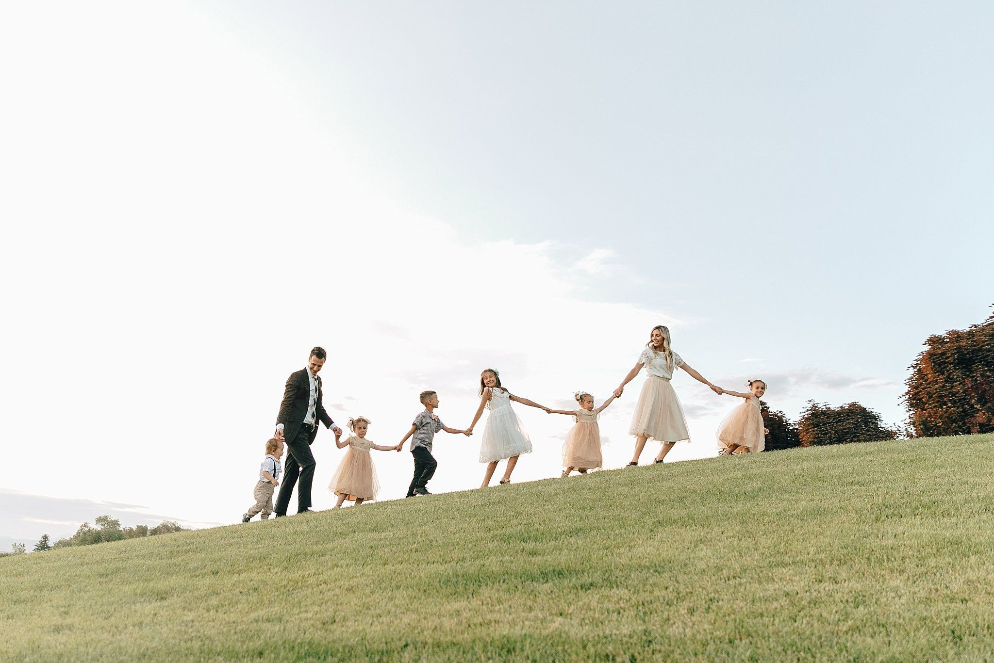 Family pictures at the temple logan utah temple with six