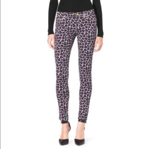 Michael Kors skinnies Pink, black and white leopard print skinny jeans. Pair with heels and a black top for a chic look  Took off the tags, but never wore them because they don't quite fit me  Michael Kors Pants