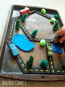 Magnetic Roads with tongue depressors, pompom bushes, pipe cleaner trees, felt ponds and matchbox cars on metal cookie sheet.