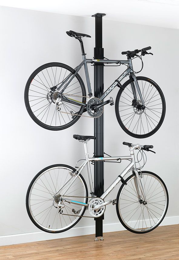 a futuristic looking floor to ceiling bike rack that will on top new diy garage storage and organization ideas minimal budget garage make over id=11123