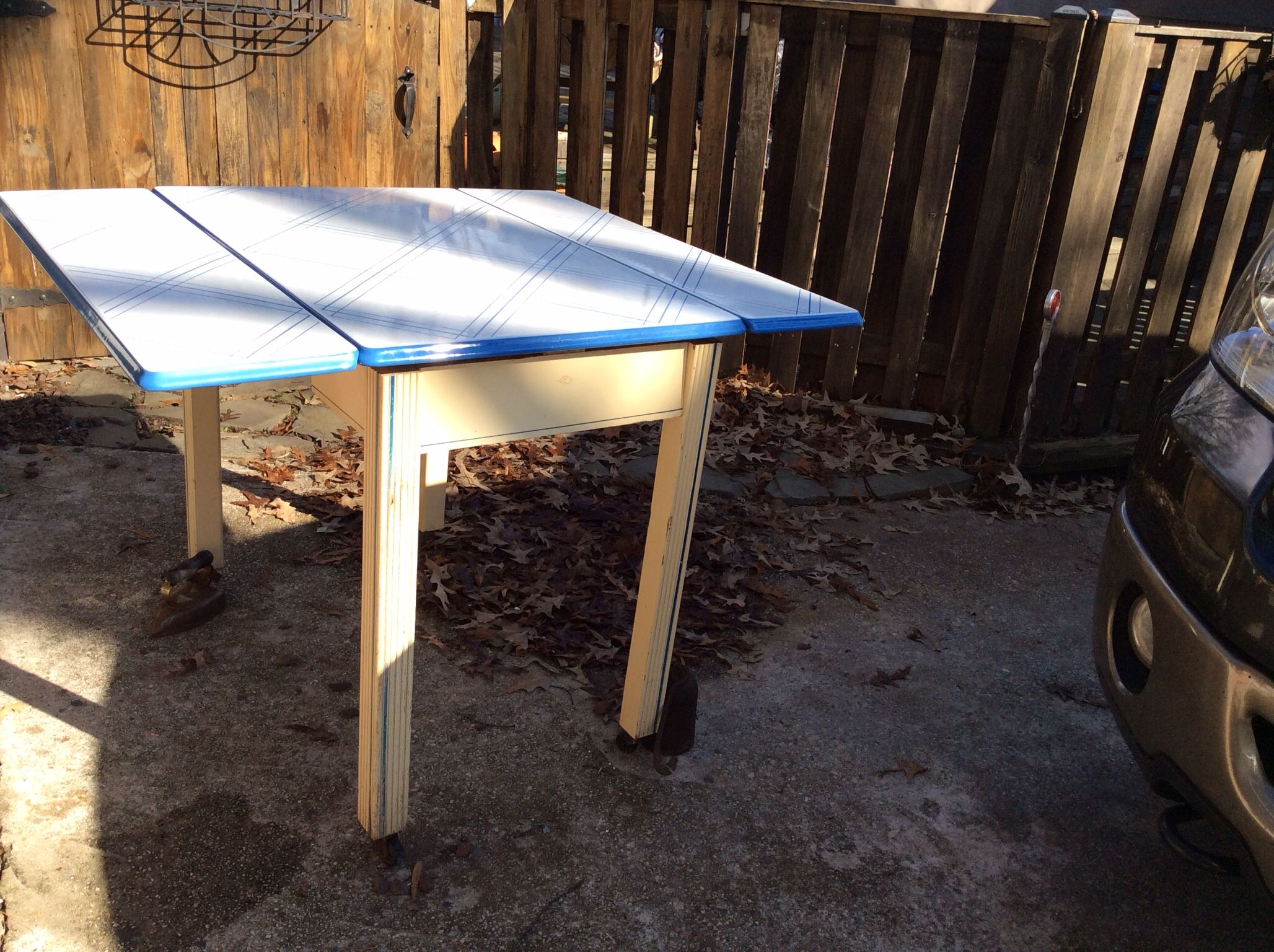 White and blue strip design porcelain top table will be at Antique Crossroads soon.