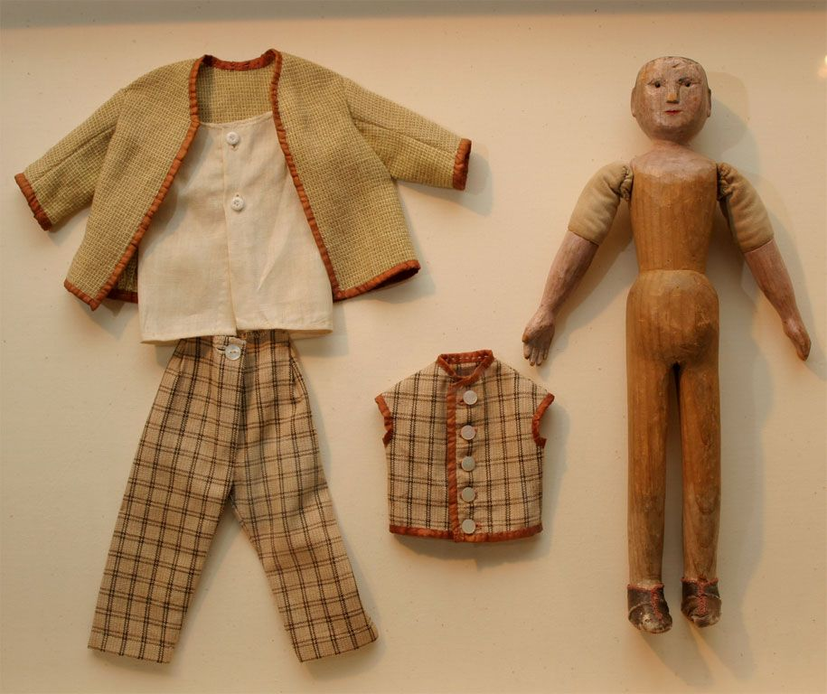 Antique american carved wooden doll with clothes