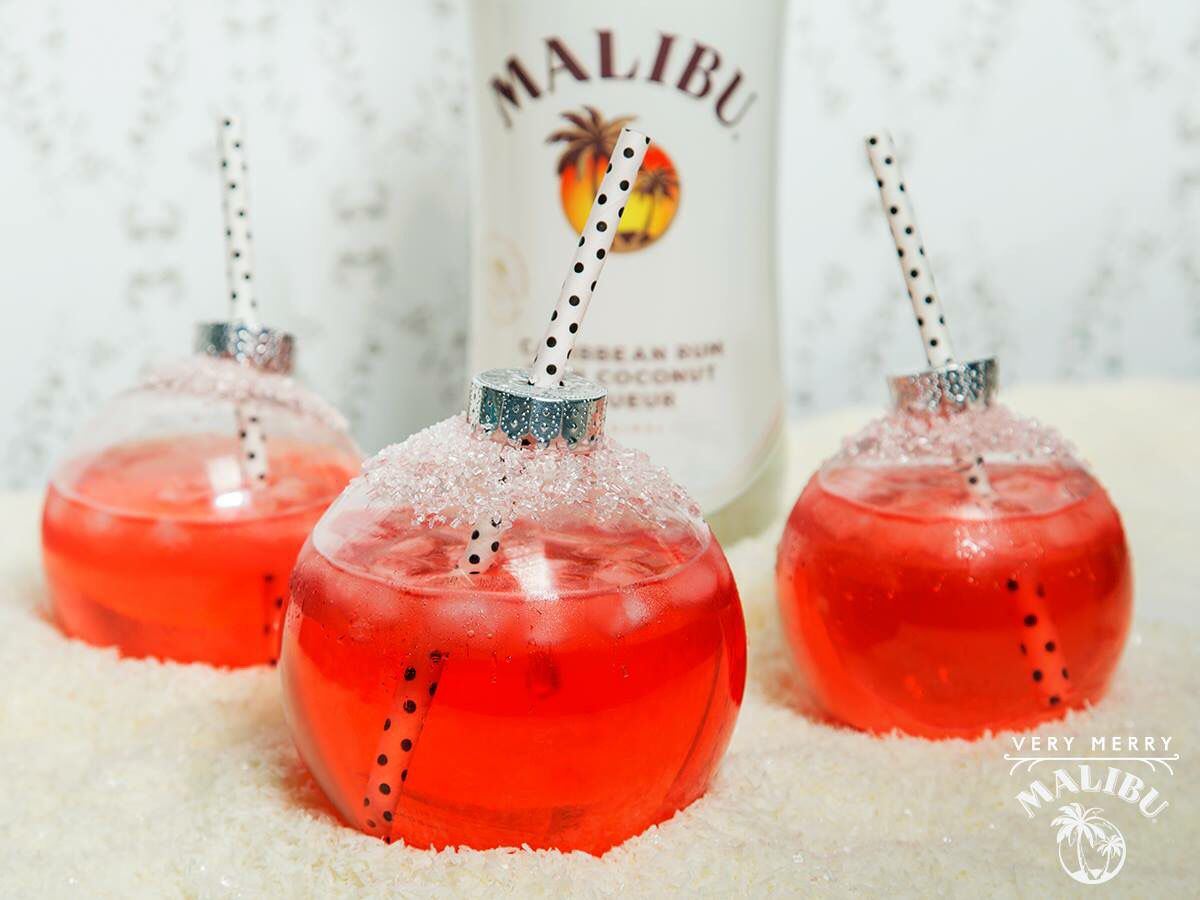Christmas Bauble Punch! Ingredients: 2 parts Malibu Rum, 1 part Grenadine, 1 part lime juice, 1 part ginger ale, and a plastic bauble. Instructions: combine all ingredients in a shaker filled with ice, shake well, and carefully pour into the plastic bauble through a funnel. Insert a straw, and enjoy!!