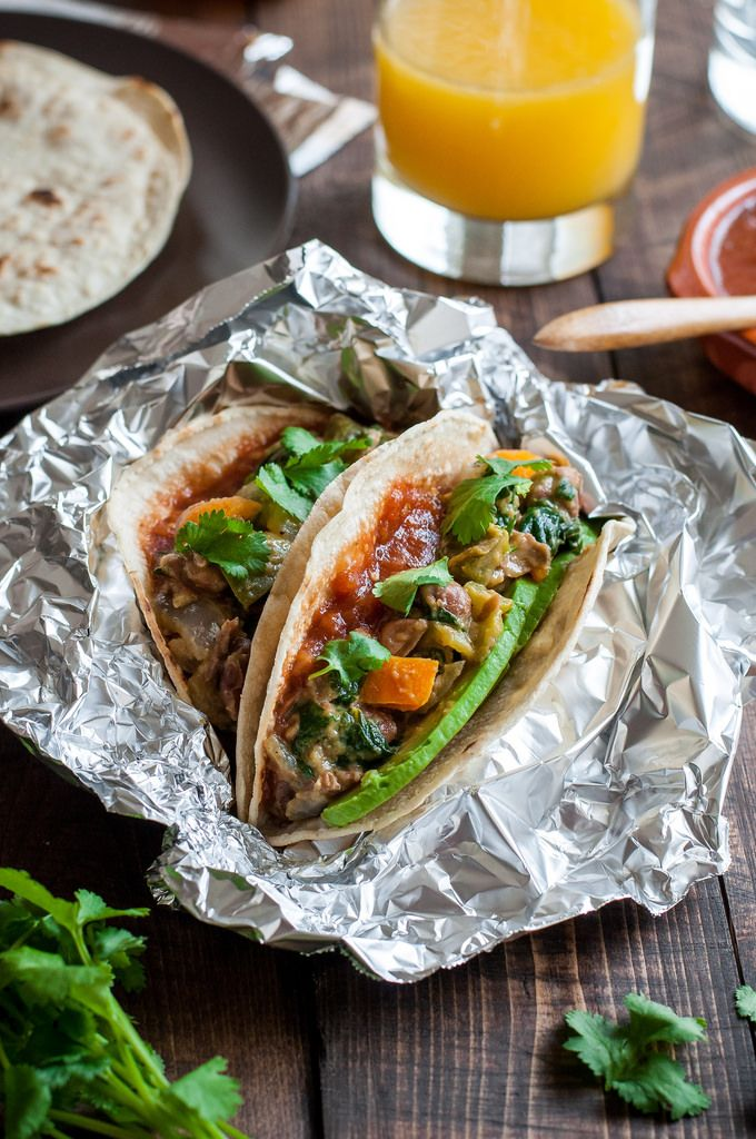 Vegan breakfast tacos filled with a quick, healthy mix of beans and veggies are easy to make ahead for the whole week! Without a mushy tortilla in sight.