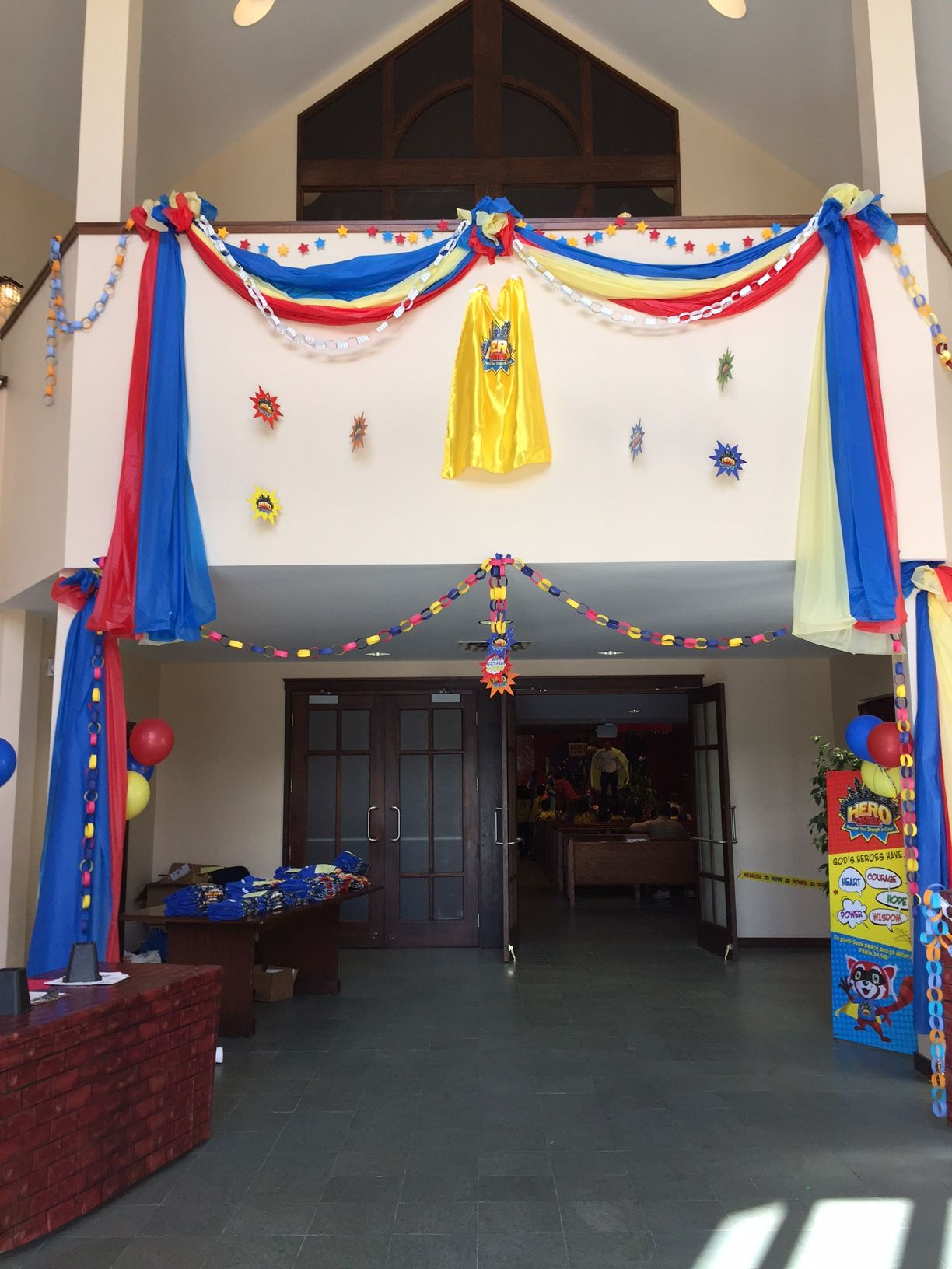Used Red Blue And Yellow Plastic Tablecover To Create This Look Added The Chains And A Cape