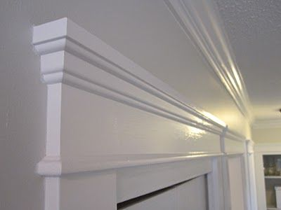 Flat Modern Baseboards And Plinth Blocks With More Traditional Architrave Headers And Crown