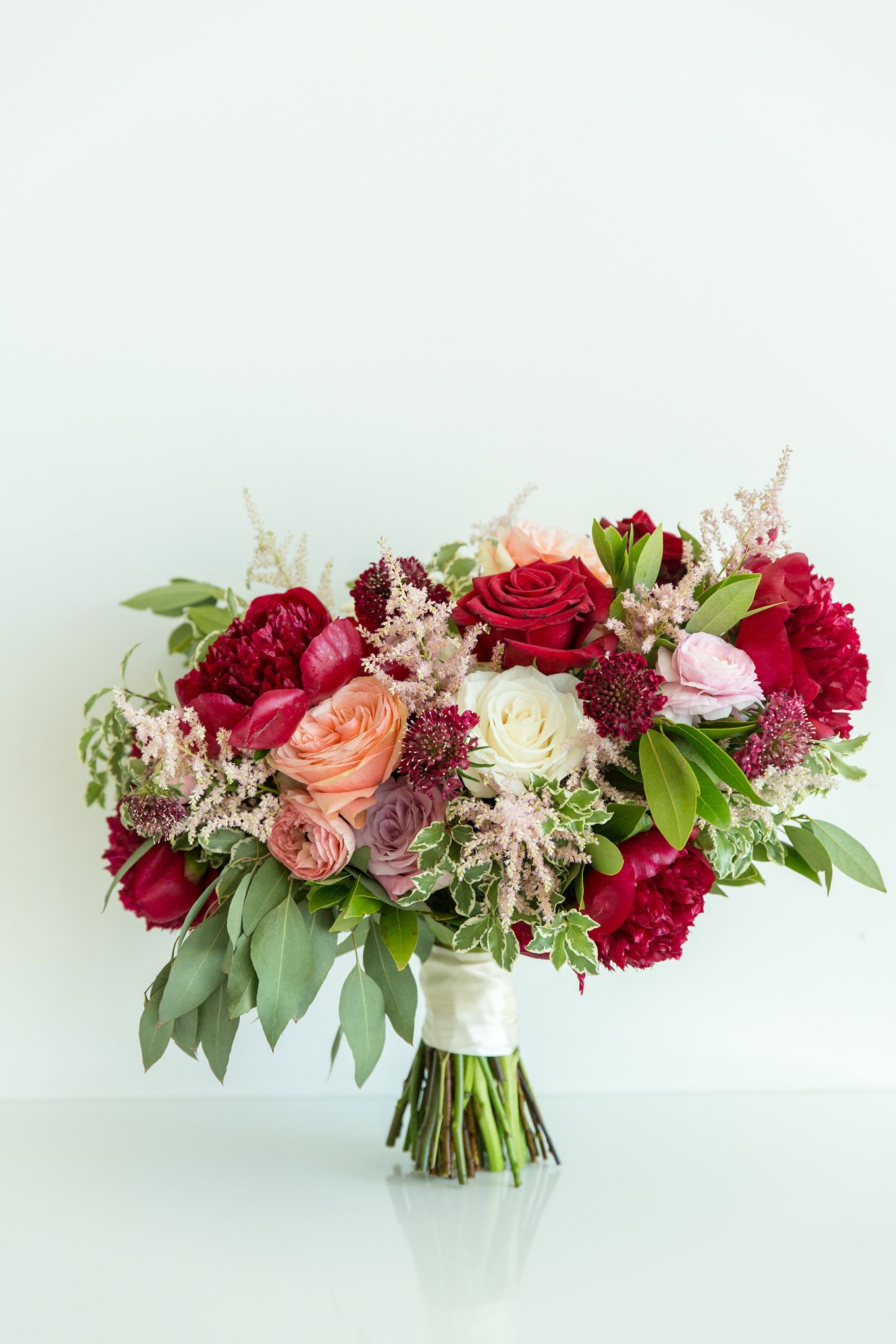 Burgundy peonies with peach and blush Wedding flowers