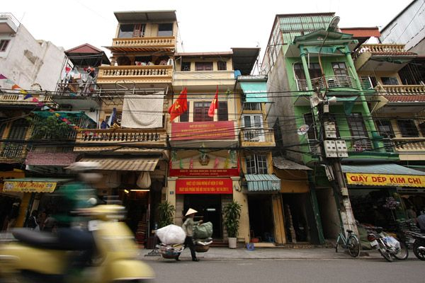 Narrow buildings are iconic for Vietnam, and no place is it more extreme than in Hanoi. Plots have been split and split until the front is no wider than a double bed. There are never any windows on the side of the building and paint is something that is only used on the facade.
