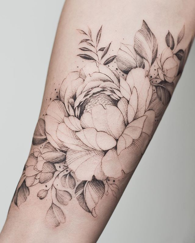 "Tritoan Ly's Instagram post: ""Floral forearm piece for my lovely client who bought me socks with Paxton and Yuki's face on it 🙏🏼 best gift ever"""