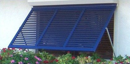 Slatted Metal Awning For Front Picture Window Gives Us