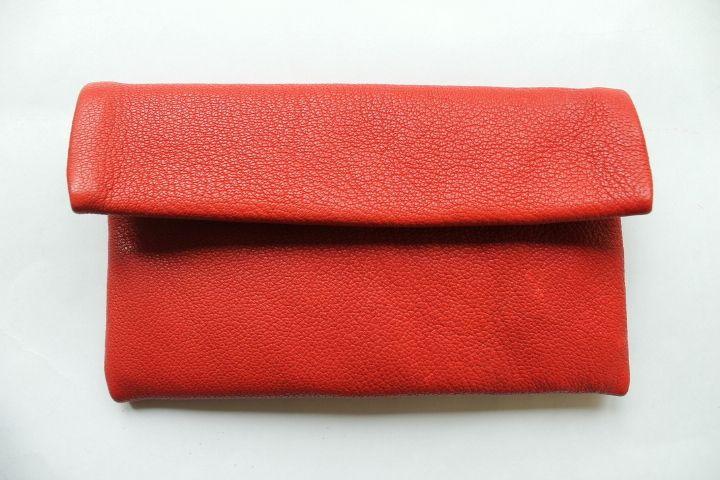 red leather wallet by nastya klerovski