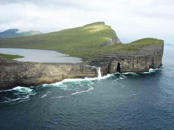 "Sørvágsvatn/Leitisvatn is a large lake in the Faroe Islands. The biggest lake of the islands, it is situated on the island of Vágar between the municipalities of Sørvágs Kommuna and Vága kommuna. The name Sørvágsvatn means ""The lake of Sørvágur""."