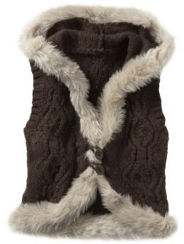 Fur trim adds standout style to a classic cable-knit sweater vest ...