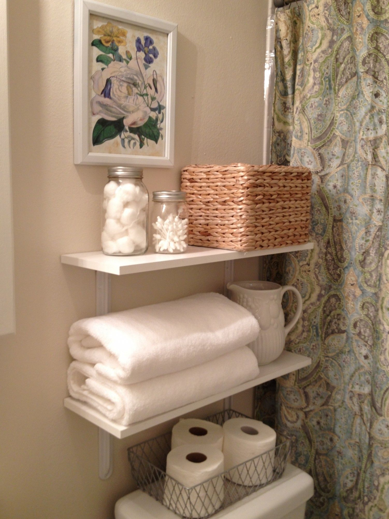Towel Storage Ideas Small Bathroom Part - 43: Simplistic White Open Shelves Over Toilet Storage For Towel Place And  Tissue Storage Also Cool Grey Floral Shower Curtain In Cream Bathroom  Designs