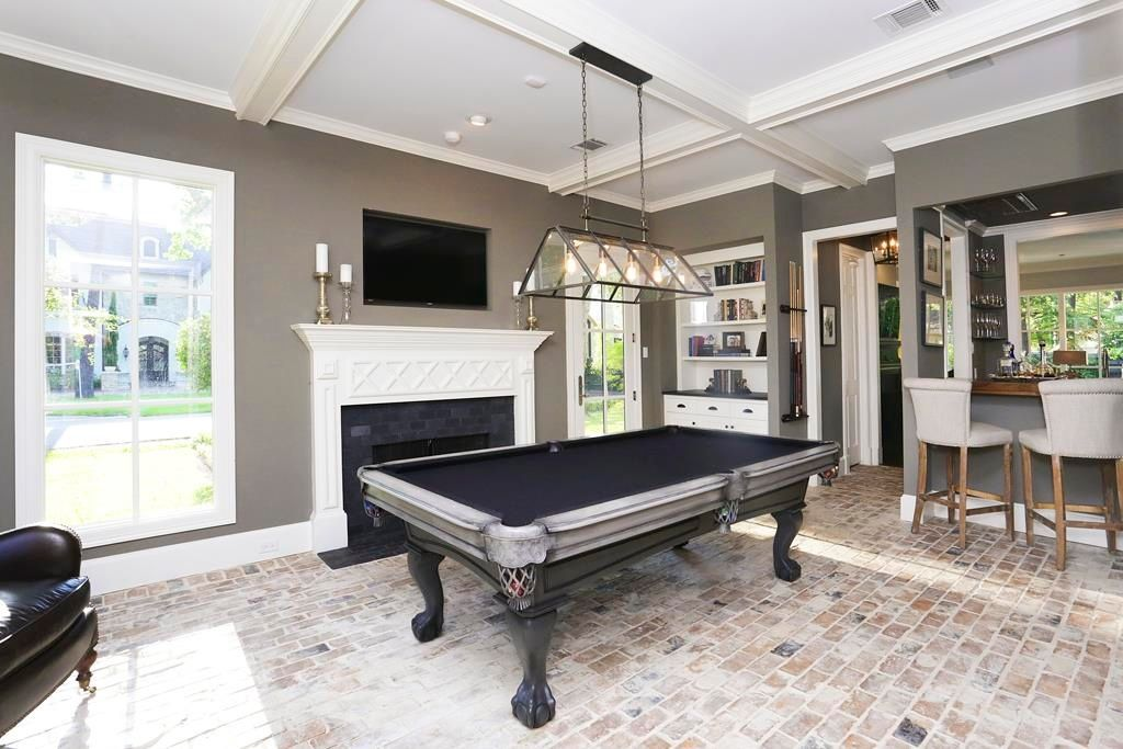 Great traditional game room with high ceiling pendant