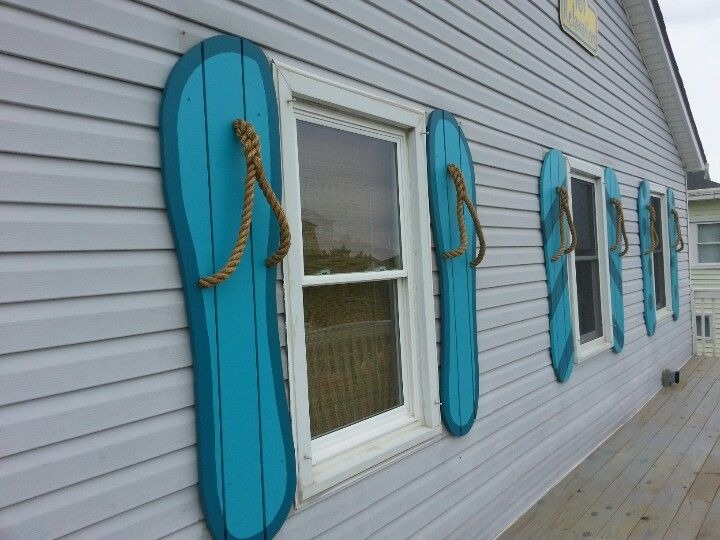 Flip flop shutters beach cottage style pinterest for Beachy exterior shutters